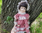 Ashley porcelain doll from Wyndham Lane with hand painted features, brown hair, dusty rose dress and bonnet with white lace, girl birthday