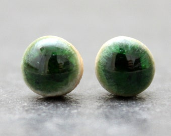 Dark green crackle ceramic stud earrings with Sterling Silver push back closure. Dainty style that makes a BIG statement!