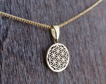 small pendant with the pattern of the flower of life on necklace brass