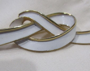 "Trifari Ribbon Knot Brooch Pin. White with Gold Trim. 3"" X .75"""