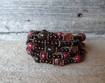 New earth colored stones memory wire bracelet with dark tiger stones, wonderful colors on this one.....come look :)