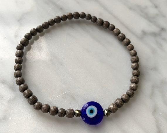 Itty Bitty Cobalt Blue Glass EVIL EYE + Pyrite Healing Bracelet w/Gray Wood Beads//Healing Bracelet// Evil Eye Bracelet// Protection Jewelry
