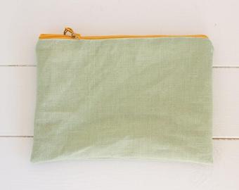 Sapphira-waxed cotton clutch bag