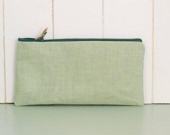 Kala-flat waxed cotton clutch bag