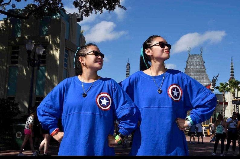 Ready to Ship Avengers M Sparkle Jersey Woman/'s Girl/'s Vinyl Pom Pom Jersey Shirt Iron Man Captain America Hulk Spiderman Thanos Wasp SALE