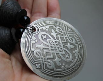CELTIC disc.  Artisan necklace with unique pendant and spindle whorl beads. African tribal influence. designer OOAK