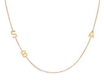 triple 14k gold asymmetrical initial necklace