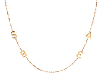 4 14k gold asymmetrical initial necklace