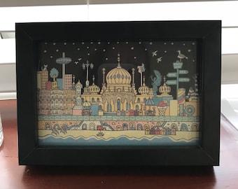 Brighton 'Starlight' artwork in a black frame.