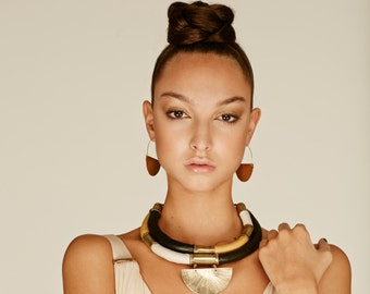 Statement necklace for women. Leather Bib necklace with African style with brass pendant. Trendy tribal necklaces for sophisticated women.