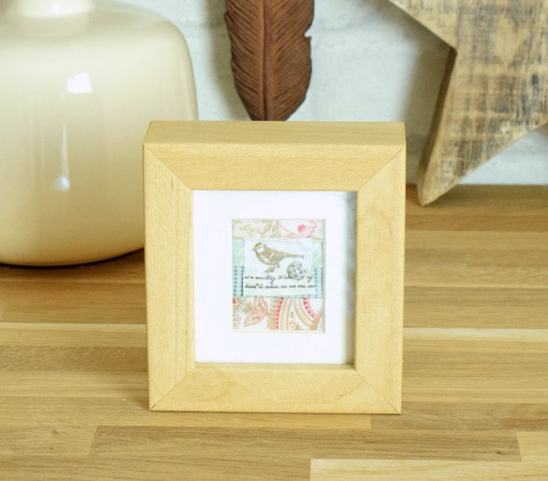 and finished with a tiny spotted button Small vintage style framed fabric collage featuring a tiny bird motif