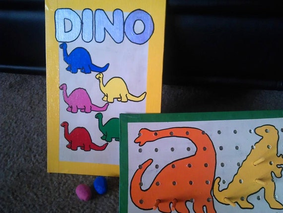 Double sided dinosaur color board and pegboard set
