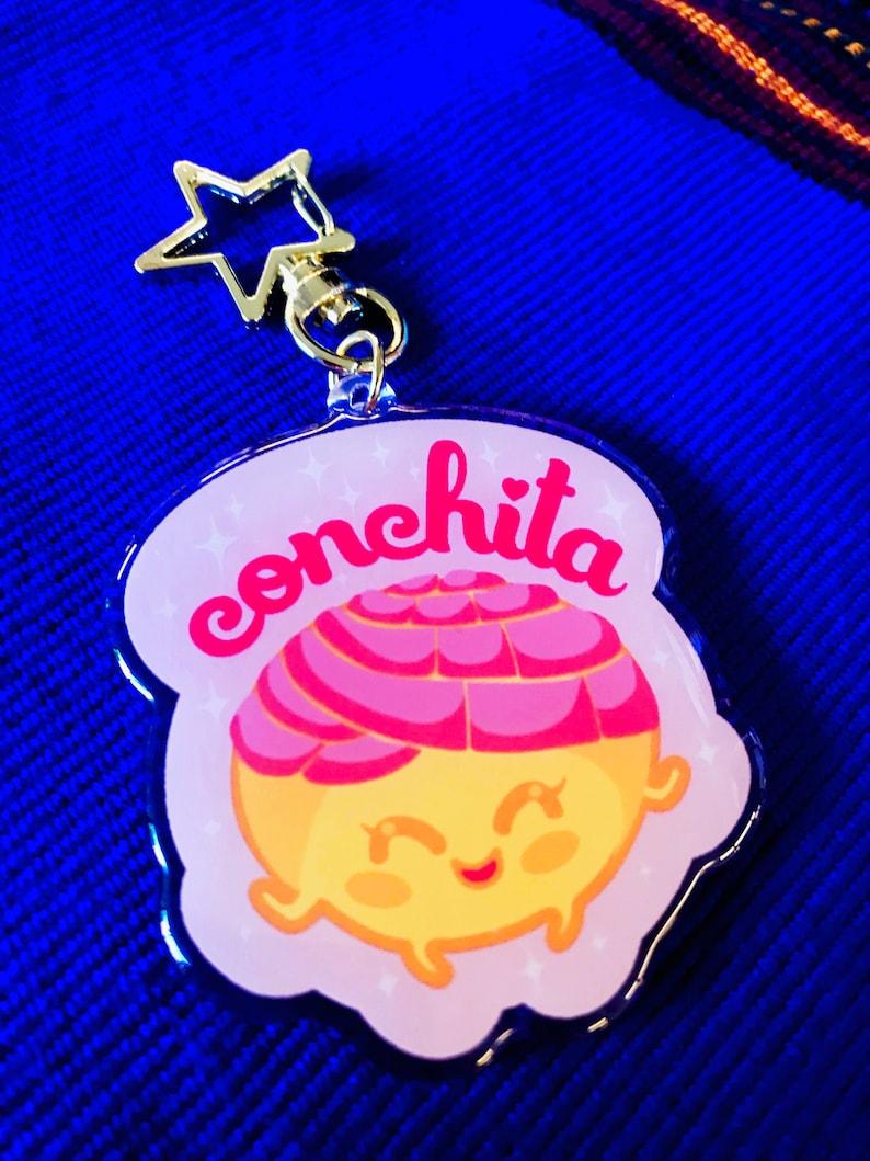 Conchita Acrylic charm image 0