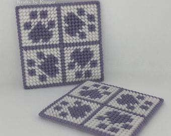 Purple Paw coaster, four paw design rotating, yarn on plastic canvas