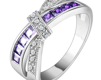 Ginger Lyne Collection Veranda Cross Gold Plated Love Knot Purple Clear Cubic Zirconia Ring