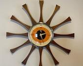 20 inch Hand Made Mid Century style Starburst Cartwheel Clock by Royale - Hand Waxed Mahogany Teakood Rays with a Tangerine Eye Face