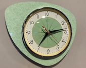 Handmade Asymmetric Queens Gambit style Wall Clock in Jadeite Green with Starburst Dial from Royale - Midcentury French Atomic Retro.
