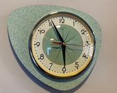 Handmade Asymmetric Queens Gambit style Wall Clock in Sage Green with Starburst Dial from Royale - Midcentury French Atomic Retro.