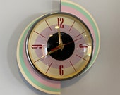 Colour Etched Spinning Meteor Caravan Wall Clock from Royale - Pastel Pink Green Cream Midcentury Atomic Jetsons Retro style.