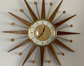 21 inch Hand Made Mid Century style Majestic Starburst Clock by Royale Medium Waxed Teak Rays Burnt Gold 1950s Face Goldtone Frame