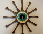 20 inch Hand Made Mid Century style Starburst Cartwheel Clock by Royale - Hand Waxed Mahogany Teakood Rays with a Turquoise Eye Face