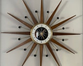27 inch Hand Made Mid Century style Majestic Starburst Clock by Royale Medium Teak Rays, Black Goldtone