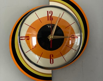 Colour Etched Spinning Meteor Formica Caravan Wall Clock from Royale - Midcentury Atomic 1970's Retro style.
