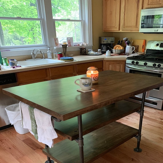 Industrial pipe and wood kitchen island    steel and wood island    kitchen  table