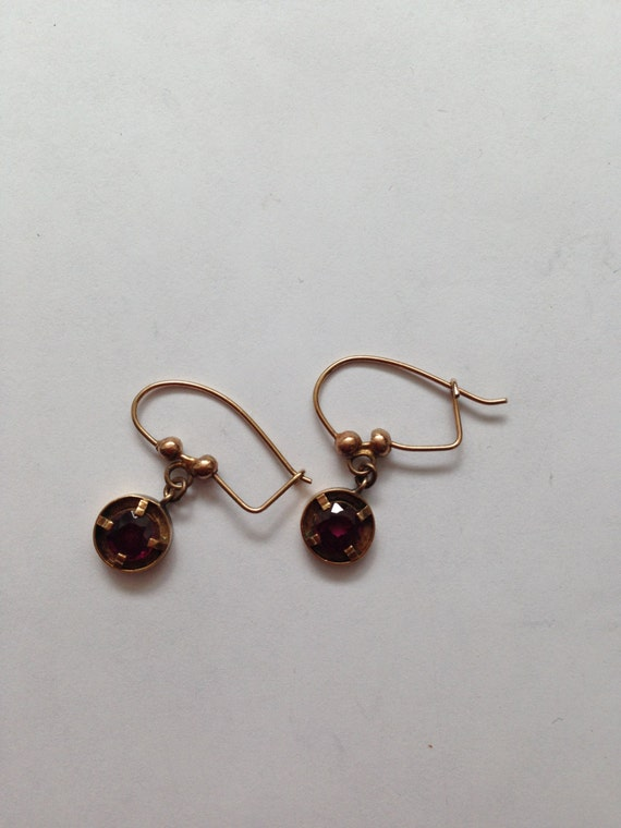 Dainty Victorian gold dangle earrings with garnets