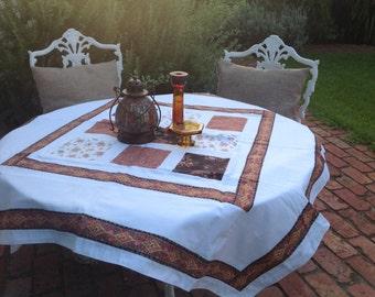 Patchwork cotton square tablecloth / picnic blanket. Crisp white background with pretty vintage bohemian style trim.