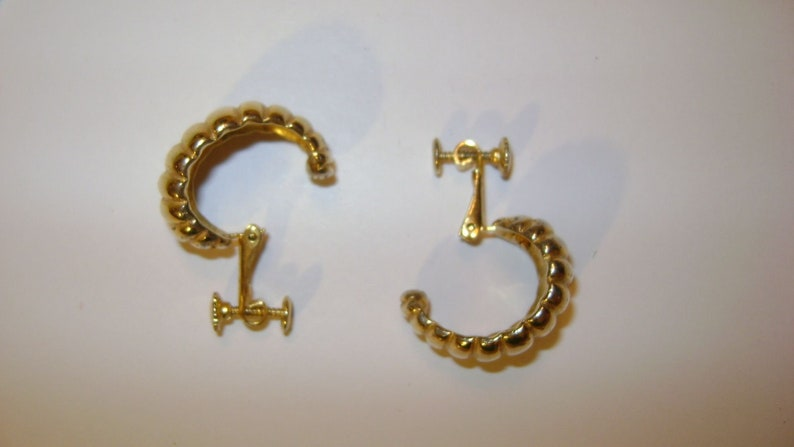 2 Pair lot of vintage gold tone clip earrings 1 pair is signed Goldette
