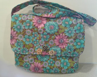 "Bright floral fabric shoulder bag, self-closing flap, 36"" long strap, 11.5"" high, 10"" wide. Mini roses on flap."