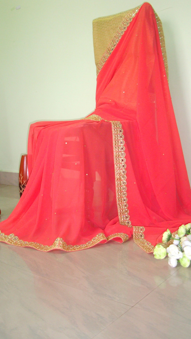 crimson color  saree beautiful saree,saree blouse designer saree saree indian saree Georgette saree fancy saree saree for women