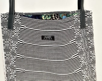 Handwoven bag/shopper black and white with blue-green coloured leather bottom