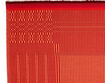 handwoven placemat in warp -dominated rep weave technique