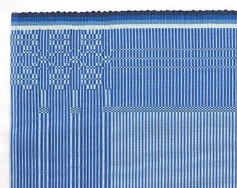 blue placemat with flower pattern handwoven