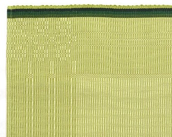 handwoven placemat or table linen with flower pattern green
