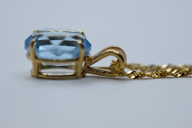 18 Inches 14k Gold Blue Topaz Necklace Pendant on a 14k Gold Rope Style Chain