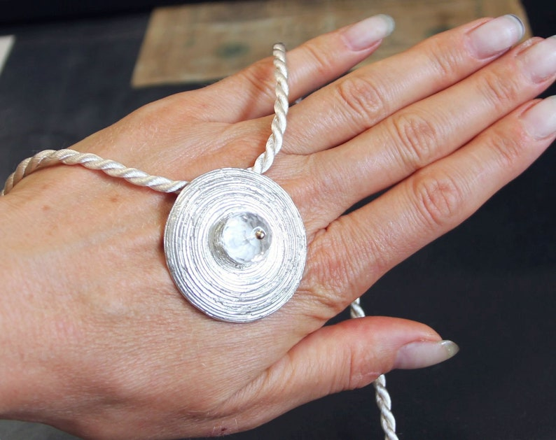 rock crystal pendant with spiral pattern of 925silver and 750gold