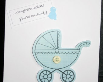 Handmade 'Congratulations'  card wih a pram and finished with a little button