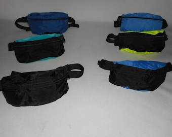Fanny pack Medium size nylon assorted colors Made in USA.