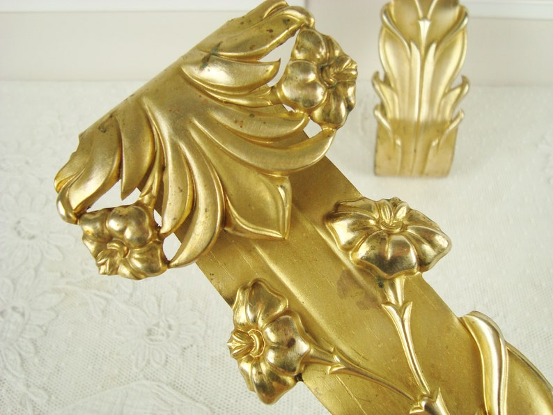 Art Nouveau tie back hooks in repousse brass from a French chateau circa 1900