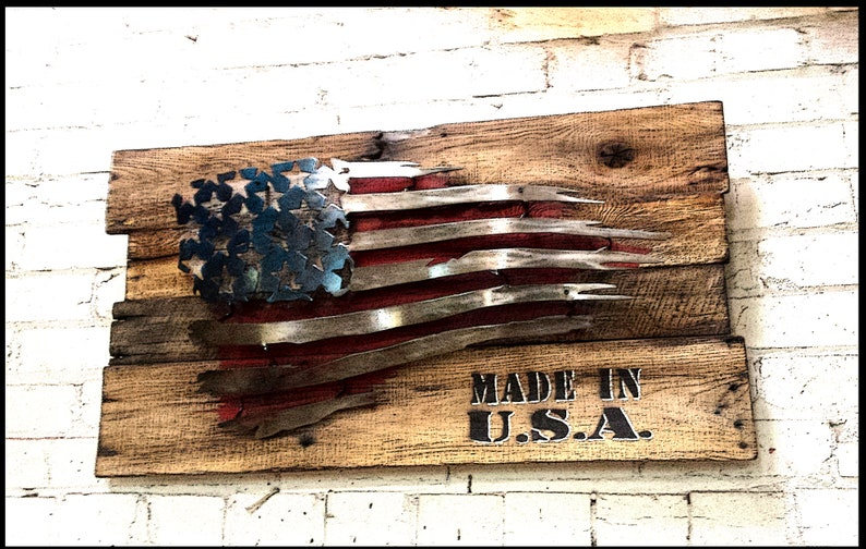 1eaf9f3bf7f Ripped   tattered U.S. steel flag with reclaimed wooden frame