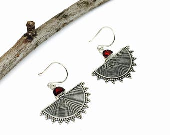 Garnet earrings set in sterling silver 92.5 Genuine natural garnet stones. Perfectly matched stones.Satisfaction guaranteed