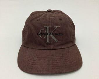 Vintage CALVIN KLEIN JEANS cK Logo Manhattan Snapback Cap One Size c3680961b