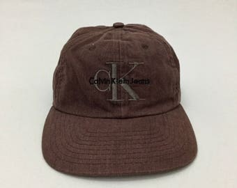Vintage 90  CALVIN KLEIN JEANS cK Designer Logo Manhattan Snapback Cap  Adjustable c2723af7e0d