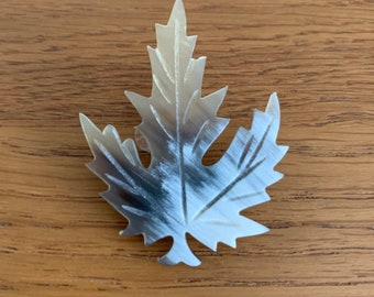 Lucite / Early Plastic Snowy Leaf Brooch