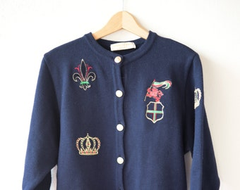 vintage wool cardigan jacket GABRIELLE ZURN blue gold button front royal crown symbol crest crew neck collar long sleeve soft wool knit MED