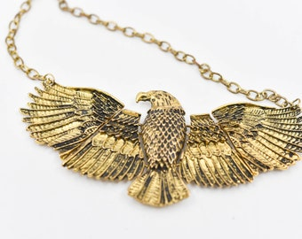 winged eagle vintage gold tone metal necklace articulated open wings Egyptian revival bird of prey falcon symbol theme pendant jewellery 51g