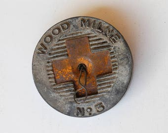 antique shoe heel pad plug rubber and metal salvage WOOD MILNE No 3 industrial rubber rusty cross motif 1900s Victoriana collectible rare